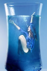 Woman in a glass of water