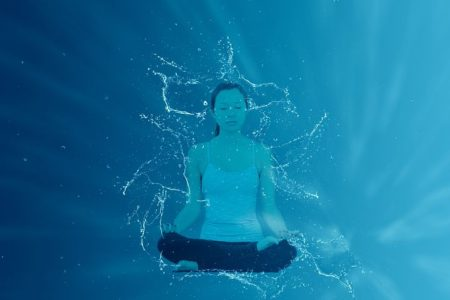 Woman in seated Meditation- Lotus position